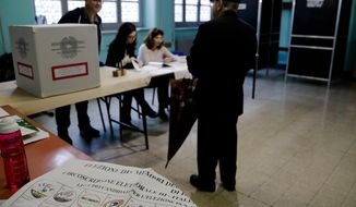 A man arrives to vote at a polling station in Rome, Sunday, May 26, 2019. Pivotal elections for the European Union parliament reach their climax Sunday as the last 21 nations go to the polls and results are announced in a vote that boils down to a continent-wide battle between euroskeptic populists and proponents of closer EU unity. (AP Photo/Alessandra Tarantino)