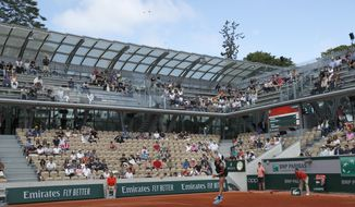 The new Simonne Mathieu court is seen as Spain's Garbine Muguruza serves against Taylor Townsend of the U.S. during their first round matches of the French Open tennis tournament at the Roland Garros stadium in Paris, Sunday, May 26, 2019. (AP Photo/Pavel Golovkin)
