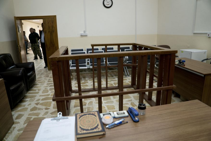 in this Thursday, April 26, 2018, file photo, the defendant's cage is in the center of an empty courtroom at Nineveh Criminal Court, one of two counterterrorism courts in Iraq where suspected Islamic State militants and their associates are tried, in Tel Keif, Iraq. (AP Photo/Maya Alleruzzo, File)
