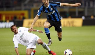 Empoli's Ismael Bennacer, left, challenges Inter Milan's Ivan Perisic during the Serie A soccer match between Inter Milan and Empoli, at the San Siro Stadium in Milan, Italy, Sunday, May 26, 2019. (AP Photo/Antonio Calanni)