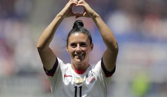 Ali Krieger, a defender for the United States women's national team which is headed to the FIFA Women's World Cup, is introduced to fans during a send-off ceremony following an international friendly soccer match against Mexico, Sunday, May 26, 2019, in Harrison, N.J. (AP Photo/Julio Cortez)