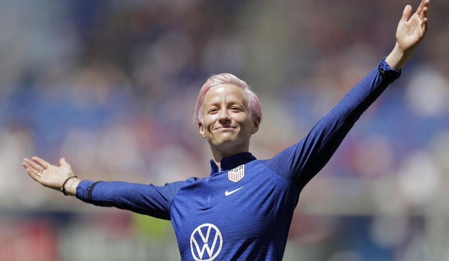 Megan Rapinoe, a forward for the United States women's national team, which is headed to the FIFA Women's World Cup, is introduced for fans during a send-off ceremony following an international friendly soccer match against Mexico, Sunday, May 26, 2019, in Harrison, N.J. The U.S. won 3-0. (AP Photo/Julio Cortez) ** FILE **