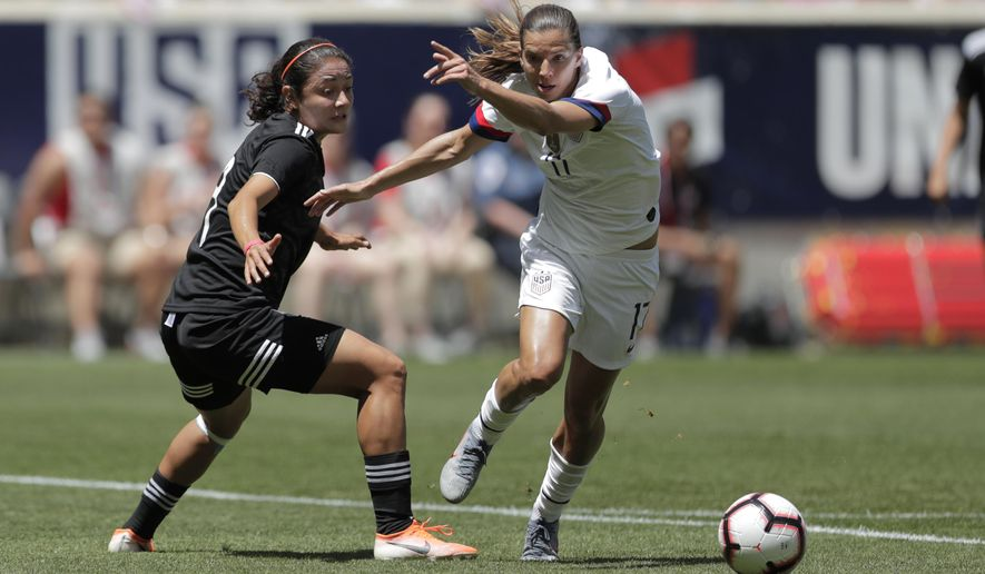 United States forward Tobin Heath, right, steals the ball from Mexico defender Rebeca Bernal before scoring a goal during the first half of an international friendly soccer match, Sunday, May 26, 2019, in Harrison, N.J. (AP Photo/Julio Cortez)