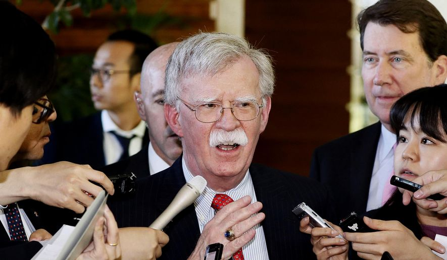 "In this Friday, May 24, 2019, file photo, U.S. National Security Adviser John Bolton is surrounded by reporters at the prime minister's official residence in Tokyo, Japan. North Korea on Monday, May 27, 2019, has called U.S. National Security Adviser Bolton a ""war monger"" and ""defective human product"" after he called the North's recent tests of short-range missile a violation of U.N. Security Council resolutions. (Yohei Kanasashi/Kyodo News via AP, File)"