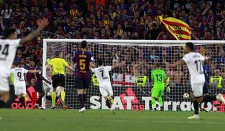 Valencia players celebrate their team's second goal during the Copa del Rey soccer match final between Valencia CF and FC Barcelona at the Benito Villamarin stadium in Seville, Spain, Saturday. 25, 2019. (AP Photo/Miguel Morenatti)