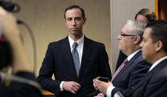 In this Feb. 7, 2019 file photo, Secretary of State David Whitley, left, arrives for his confirmation hearing in Austin, Texas. Whitley, Texas' embattled elections chief, is on the brink of losing his job over wrongly questioning the U.S. citizenship of thousands of voters. Secretary of State David Whitley on Sunday, May 26, 2019 was set to be forced from office unless the Texas Senate confirmed his nomination. But that prospect was dimming as Democrats continued blocking a vote on the eve of the Legislature adjourning until 2021.  (AP Photo/Eric Gay, File)