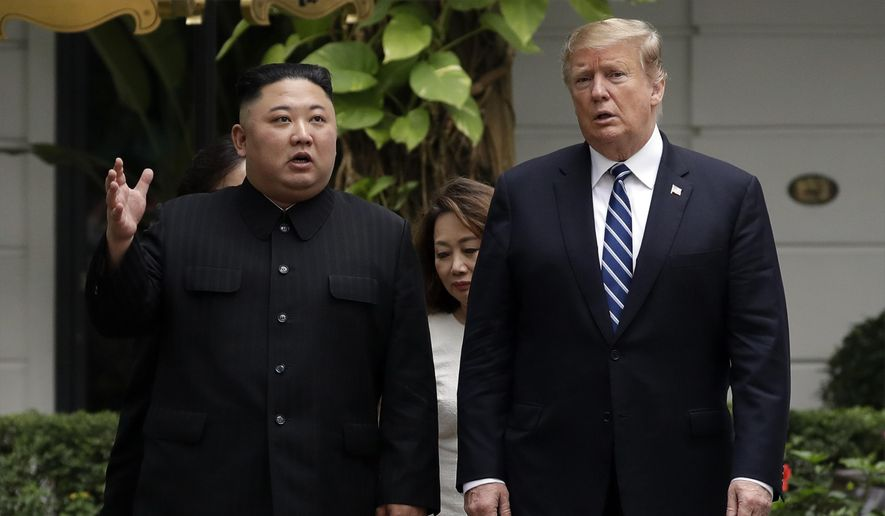 FILE - In this Feb. 28, 2019, file photo, U.S. President Donald Trump and North Korean leader Kim Jong Un take a walk after their first meeting at the Sofitel Legend Metropole Hanoi hotel in Hanoi, Vietnam. North Korea says nuclear negotiations with the United States will never resume unless Washington changes its negotiating tactics.  (AP Photo/Evan Vucci, File)