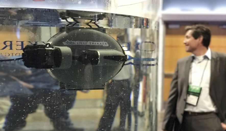 In this photo taken Tuesday, May 16, 2017, an underwater drone is seen in a tank at the Special Operations Forces Industry Conference in Tampa, Fla. The conference is for military special operations forces featuring gadgets, weapons and tools. (AP Photos/ Tamara Lush)
