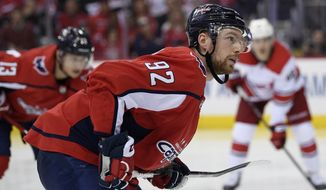 FILE - In this April 24, 2019, file photo, Washington Capitals center Evgeny Kuznetsov (92), of Russia, stands on the ice during the second period of Game 7 of an NHL hockey first-round playoff series against the Carolina Hurricanes in Washington. The Capitals say they are aware of a video on social media that appeared to show Kuznetsov in a hotel room with lines of white powder on the table in front of him and verified it is him in the video. In a statement sent to The Associated Press by spokesman Sergey Kocharov, the team says it is in the process of gathering facts and will have no further comment at this time. (AP Photo/Nick Wass) ** FILE **