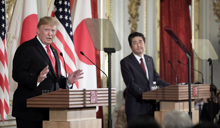 U.S. President Donald Trump, left, speaks as Japanese Prime Minister Shinzo Abe listens during a news conference at Akasaka Palace in Tokyo Monday, May 27, 2019. (Kiyoshi Ota/Pool Photo via AP)