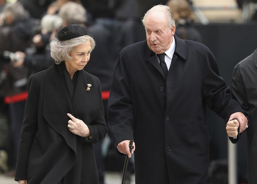 In this Saturday, May 4, 2019, file photo, Spain's emeritus King Juan Carlos, right, and emeritus Queen Sofia leave the Notre Dame cathedral after attending at the funeral of the Grand Duke Jean of Luxembourg, in Luxembourg. Spain's former monarch, Juan Carlos I, says he wants to completely retire from public life on June 2, 2019, five years after abdicating the throne. (AP Photo/Francisco Seco, file)