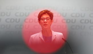 In this picture Taken with a television camera control light in the foreground German Christian Democratic Union party chairwoman Annegret Kramp-Karrenbauer attends a news conference after a board meeting at the party's headquarters in Berlin, Monday, May 27, 2019. Germany's governing parties slid to their worst post-World War II showing in a nationwide election at the European Parliament elections yesterday. Chancellor Angele Merkel's center-right Union bloc drops down from 35.4 to 28.9 percents. (AP Photo/Markus Schreiber)