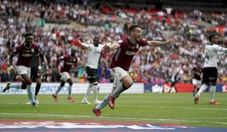 Aston Villa's John McGinn celebrates scoring his side's second goal of the game during the English Championship Play-off soccer final between Aston Villa and Derby County at Wembley Stadium, London, Monday, May 27, 2019. (Scott Wilson/PA via AP)