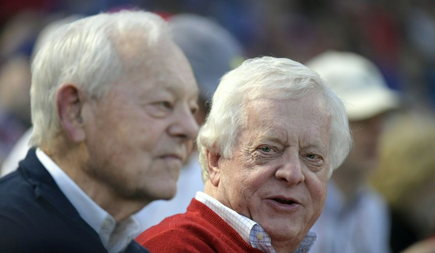 Bob Schieffer, left, Tom Schieffer enjoying the game as Angels play Rangers at Globe Life Park in Arlington, Texas, Wednesday, April 11, 2018.  Between them, the Schieffer brothers of Fort Worth have moderated presidential debates, anchored network newscasts for 35 years, built a pro baseball stadium and team and served America as one of our leading diplomats. (Max Faulkner/Star-Telegram via AP)