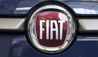 In this Feb. 14, 2019, file photo, the Fiat logo is mounted on a 2019 500 L on display at the 2019 Pittsburgh International Auto Show in Pittsburgh. Fiat Chrysler is proposing a merger with French carmaker Renault aimed at saving billions of dollars for both companies. (AP Photo/Gene J. Puskar, File)