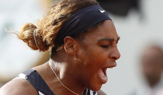 Serena Williams of the U.S. screams after scoring a point against Vitalia Diatchenko of Russia during their first round match of the French Open tennis tournament at the Roland Garros stadium in Paris, Monday, May 27, 2019. (AP Photo/Pavel Golovkin)