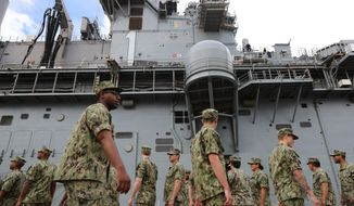 U.S. troops gather on the USS Wasp where U.S. President Donald Trump will deliver Memorial Day remarks to the troops, at the U.S. Military Base in Yokosuka, south of Tokyo, Tuesday, May 28, 2019. (AP Photo/Eugene Hoshiko) **FILE**