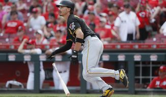 Pittsburgh Pirates' Bryan Reynolds hits a two-run double off Cincinnati Reds relief pitcher David Hernandez in the eighth inning during the first baseball game of a doubleheader, Monday, May 27, 2019, in Columbus. (AP Photo/John Minchillo)