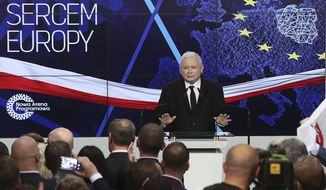 """Jaroslaw Kaczynski, leader of PiS party ,Law and Justice, gives a speech after announcing the first results of the European parliament election in Warsaw, Poland, Sunday, May 26, 2019.The poster on the wall reads """"Poland heart of Europe"""". (AP Photo/Czarek Sokolowski)"""