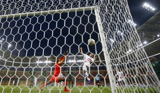 United States' Sebastian Soto, center, scores his side's opening goal during the Group D U20 World Cup soccer match between USA and Nigeria, in Bielsko Biala, Poland, Monday, May 27, 2019. (AP Photo/Sergei Grits)