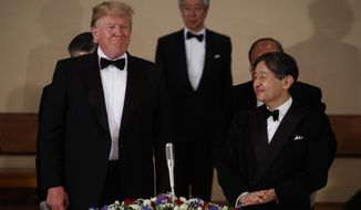 U.S. President Donald Trump stands with Japan's Emperor Naruhito during a State Banquet at the Imperial Palace, Monday, May 27, 2019, in Tokyo. (AP Photo/Evan Vucci)