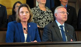 Alaska Senate President Cathy Giessel, seated left, speaks during a news conference on education funding held by state House and Senate leadership on Tuesday, May 28, 2019, in Juneau, Alaska. Seated beside her is House Speaker Bryce Edgmon. (AP Photo/Becky Bohrer)