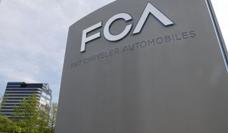 The Fiat Chrysler Automobiles world headquarters is shown in Auburn Hills, Mich., Monday, May 27, 2019. Fiat Chrysler proposed on Monday to merge with France's Renault to create the world's third-biggest automaker, worth $40 billion, and combine forces in the race to make electric and autonomous vehicles. (AP Photo/Paul Sancya)