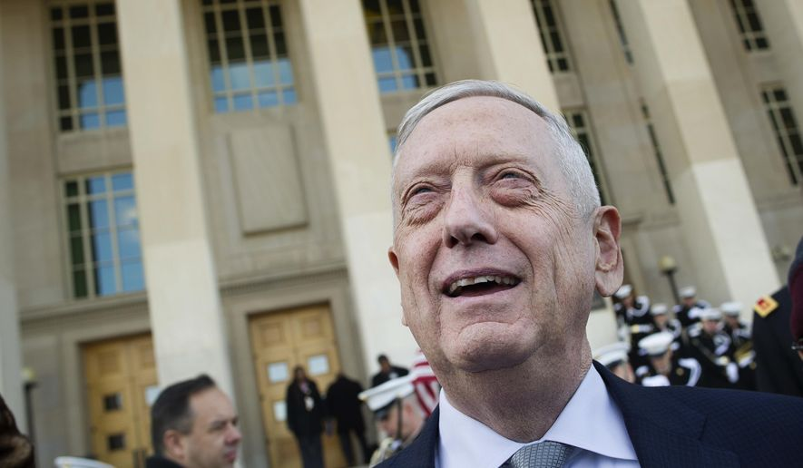 """FILE - In this Wednesday, Nov. 28, 2018, file photo, then-Secretary of Defense Jim Mattis speaks with reporters before welcoming Lithuanian Minister of National Defense Raimundas Karoblis to the Pentagon in Washington. Former Secretary of Defense Jim Mattis has a book coming, but he warns it will not be a """"tell-all"""" about President Donald Trump. (AP Photo/Cliff Owen, File)"""