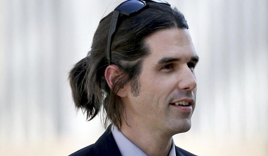In this 2018 photo, Scott Daniel Warren, who is charged with human smuggling walks in to U.S. District Court in Tucson, Ariz. Warren, a border activist charged with helping a pair of migrants with water, food and lodging, is set to go on trial on Wednesday, May 29, 2019, in U.S. court in Arizona. (Kelly Presnell/Arizona Daily Star via AP)