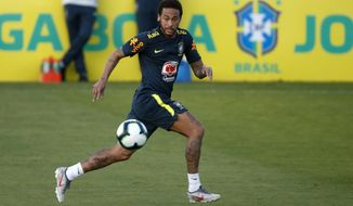 Brazil's soccer player Neymar runs for the ball during a practice session at the Granja Comary training center ahead of the Copa America tournament, in Teresopolis, Brazil, Tuesday, May 28, 2019. (AP Photo/Leo Correa)