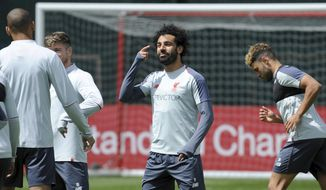 Liverpool's Mohamed Salah, center, takes part in a training session at the Liverpool soccer team media open day, in Liverpool, England, Tuesday, May 28, 2019, ahead of their Champions League Final soccer match against Tottenham on Saturday in Madrid. (AP Photo/Rui Vieira)