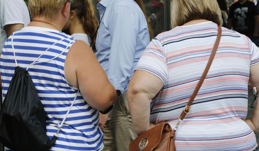 FILE - This Tuesday, Aug. 16, 2016 file photo shows two overweight women in New York. (AP Photo/Mark Lennihan)  **FILE**