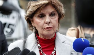 """American lawyer Gloria Allred gives a press conference, in Paris, Tuesday, May 28, 2019. The lawyer for a woman who filed a rape complaint in Paris against Chris Brown says the American rap artist """"has thumbed his nose at and shown disrespect for the French legal system"""" after he did not attend a confrontation with the alleged victim Tuesday. (AP Photo/Thibault Camus)"""