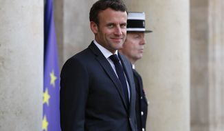 French President Emmanuel Macron, waits for the arrival of Spain's Prime Minister Pedro Sanchez prior to their meeting at the Elysee Palace, in Paris, France, Monday, May 27, 2019. (AP Photo/Francois Mori)