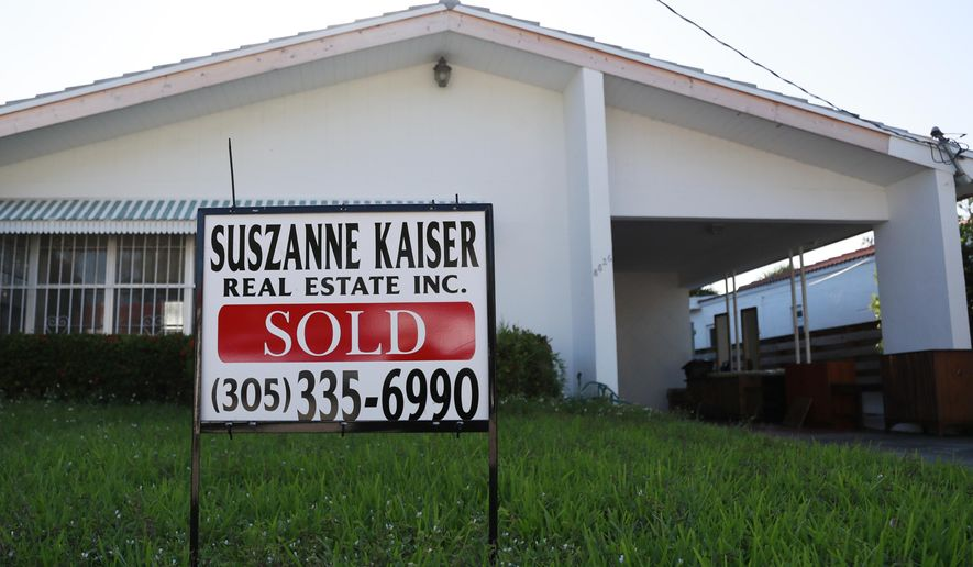FILE - In this April 12, 2019, file photo, a sold sign is shown in front of a home in Surfside, Fla. On Tuesday, May 28, the Standard & Poor's/Case-Shiller 20-city home price index for March is released. (AP Photo/Wilfredo Lee, File)