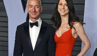 FILE - In this March 4, 2018 file photo, Jeff Bezos and wife MacKenzie Bezos arrive at the Vanity Fair Oscar Party in Beverly Hills, Calif. MacKenzie Bezos is pledging half her fortune to charity, following in the footsteps of billionaires Warren Buffett and Bill Gates. The ex-wife of Amazon founder and CEO Jeff Bezos finalized her divorce in April 2019 and reportedly got a stake in the online shopping giant worth over $35 billion. (Photo by Evan Agostini/Invision/AP, File)