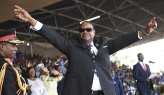 Newly elected Malawi President Peter Mutharika of The Democratic Progressive Party (DPP) waves to supporters at his swearing in ceremony at Kamuzu Stadium in Blantyre, Malawi, Tuesday May 28, 2019. Mutharika has called for unity after being sworn in for a second five-year term after an election in which opposition parties alleged irregularities. (AP Photo/Thoko Chilondi)