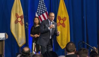 FILE - In this Nov. 6, 2018, file photo, New Mexico state auditor-elect Brian Colon delivers his acceptance speech in Albuquerque, New Mexico. New Mexico's state auditor announced Tuesday, May, 28, 2019, an examination of the state's system for settling lawsuits against the state by its employees, in the wake of secretive settlement payouts to the State Police security detail for former Gov. Susana Martinez. (AP Photo/Juan Labreche, File)