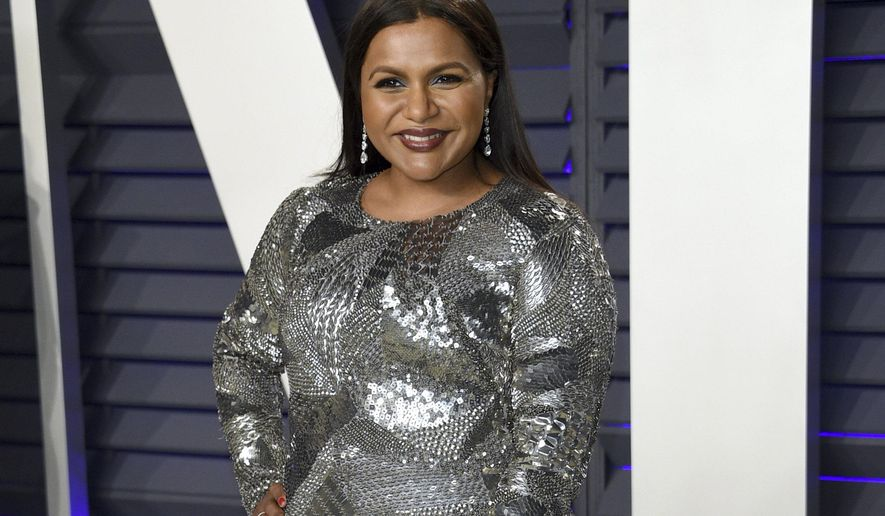 FILE - This Feb. 24, 2019 file photo shows Mindy Kaling at the Vanity Fair Oscar Party in Beverly Hills, Calif. Kaling plans to release a third collection of essays in the summer 2020. Amazon announced Tuesday, May 28, that topics will include Kaling's experience as a single mother and working with Reese Witherspoon and Oprah Winfrey. (Photo by Evan Agostini/Invision/AP, File)