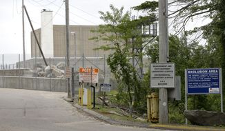Warning signs are posted near a gate to the Pilgrim Nuclear Power Station, in Plymouth, Mass., Tuesday, May 28, 2019. The operators of the nuclear plant performed a simulated shutdown at a training facility several miles from the reactor Tuesday, in advance of the actual shutdown of the aging reactor planned for Friday, May 31. (AP Photo/Steven Senne)