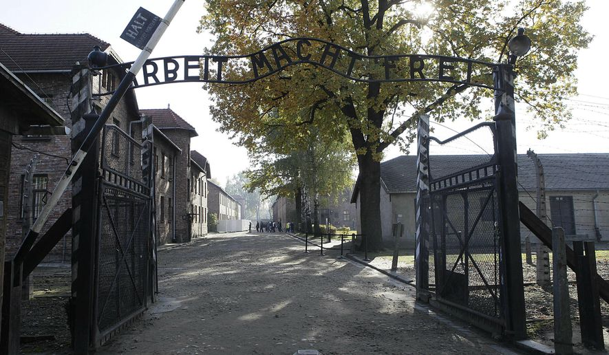"""This Friday, Oct. 19, 2012, file photo shows the entrance to the former Nazi German Auschwitz death camp with the inscription """"Arbeit Macht Frei"""" (Work Sets You Free) in Oswiecim, Poland. AP Photo/Czarek Sokolowski, file)"""