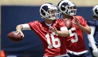 Los Angeles Rams quarterbacks Jared Goff (16) and Blake Bortles (5) go through drills during an NFL football training camp Tuesday, May 28, 2019, in Thousand Oaks, Calif. (AP Photo/Marcio Jose Sanchez)