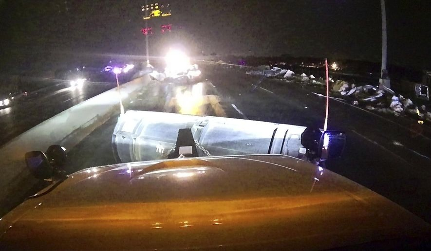 This image provided and posted by the Ohio Department of Transportation, early Tuesday, May 28, 2019, shows a view from one of the department's trucks as crews on Interstate 75 north of Dayton, Ohio, work to clean debris from the highway after a suspected tornado hit the area. (Ohio Department of Transportation via AP)