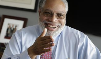 FILE - In this Sept. 21, 2017, file photo, Lonnie Bunch, director of the Smithsonian National Museum of African American History and Culture, talks about the museum's first year and his vision for the future of the exhibits, in Washington. Bunch was named May 28, 2019, as the 14th Smithsonian Secretary by the Smithsonian's board of regents. (AP Photo/J. Scott Applewhite)