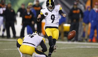 FILE  = In this Dec. 4, 2017, file photo, Pittsburgh Steelers kicker Chris Boswell (9) kicks a field goal from the hold of Jordan Berry (4) against the Cincinnati Bengals, in Cincinnati. The Steelers kicker knows his underwhelming 2018 season directly contributed to the Steelers missing the playoffs. Yet rather than reinvent his offseason routine, he doubled down confident, he could bounce back.(AP Photo/Gary Landers, File)
