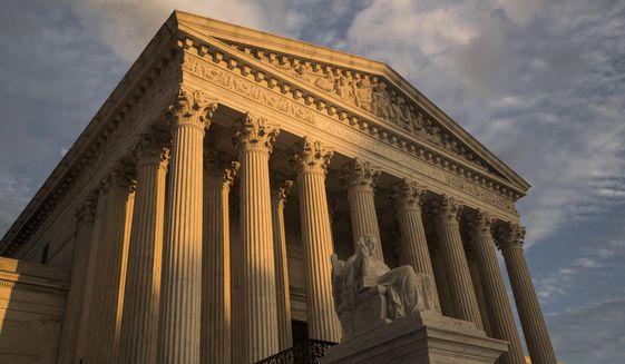 This Oct. 10, 2017, photo shows the Supreme Court in Washington at sunset. (AP Photo/J. Scott Applewhite) **FILE**