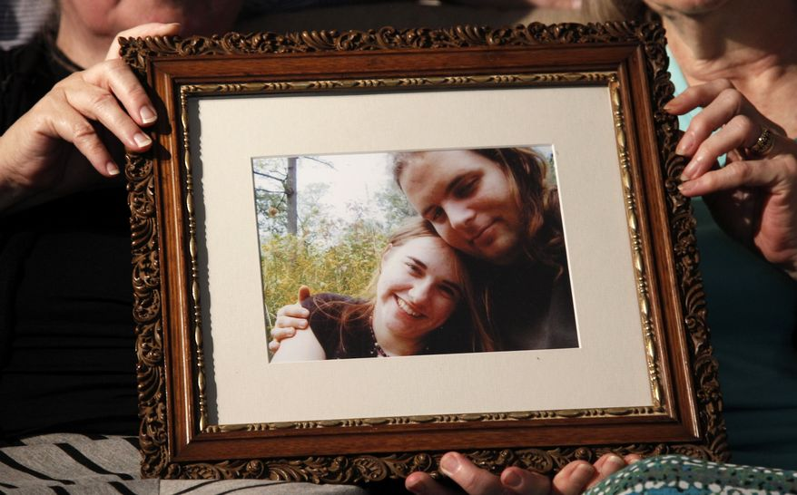 Mothers Linda Boyle, left and Lyn Coleman hold a photo of their married children, Joshua Boyle and Caitlan Coleman, who were kidnapped by the Taliban in late 2012, Wednesday, June 4, 2014, in Stewartstown, Pa. (Associated Press)