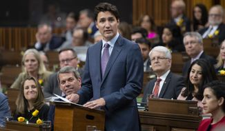 Canadian Prime Minister Justin Trudeau speaks about the USMCA trade agreement in the House of Commons in Ottawa, Ontario, Wednesday, May 29, 2019. (Adrian Wyld/The Canadian Press via AP)