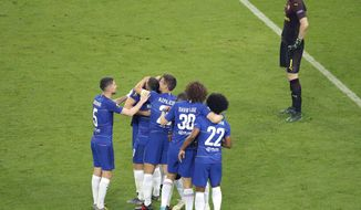 Chelsea's Eden Hazard, centre, is congratulated by teammates after scoring his team's fourth goal as Arsenal goalkeeper Petr Cech, right, reacts during the Europa League Final soccer match between Chelsea and Arsenal at the Olympic stadium in Baku, Azerbaijan, Wednesday, May 29, 2019. (AP Photo/Dmitri Lovetsky)