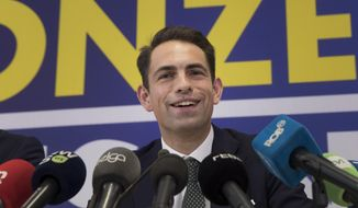 Far-right leader and chairman of the Vlaams Belang Tom Van Grieken speaks during a media conference at the party headquarters in Brussels, Monday, May 27, 2019. Vlaams Belang was the biggest winner in the Belgian elections Sunday after it had been consistently shut out of coalitions over the past quarter century. (AP Photo/Virginia Mayo)